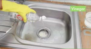 try vinegar to fix clogged drains